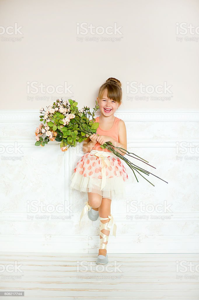 Girl the ballerina with flowers stock photo