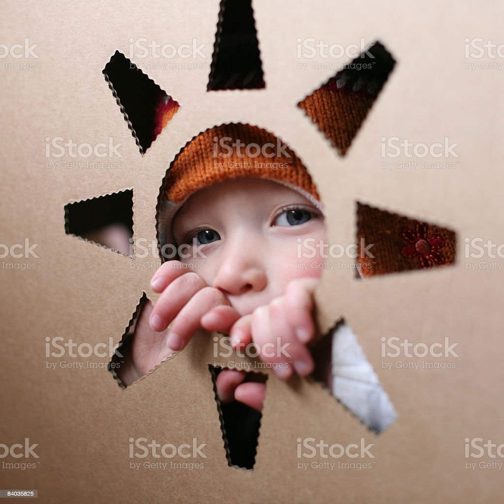Girl through cut out royalty-free stock photo