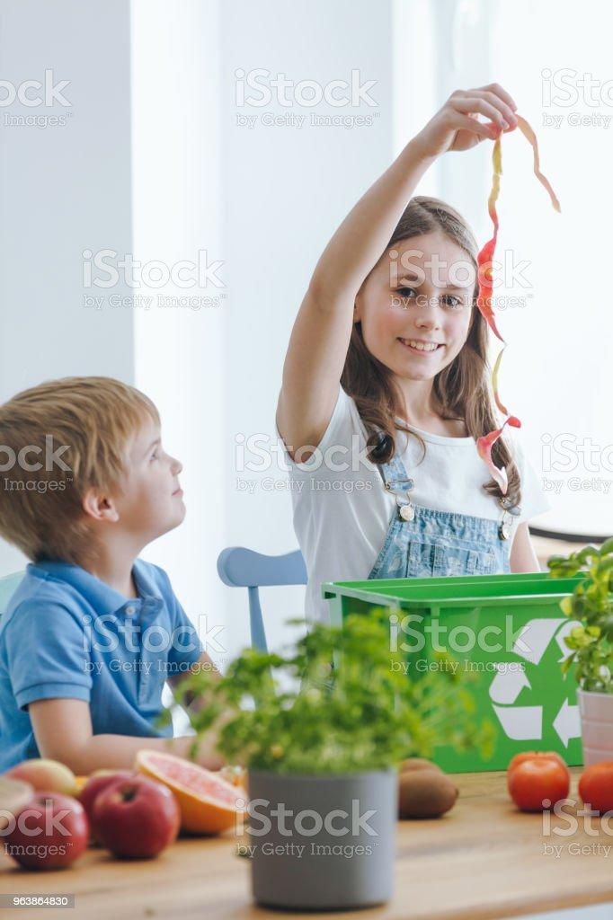 Girl throwing away biological waste - Royalty-free Alertness Stock Photo