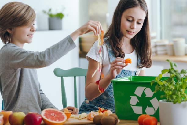 flicka kastar frukt avfall - food waste bildbanksfoton och bilder