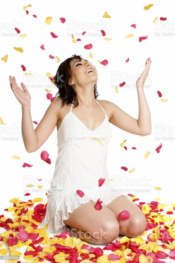 Girl throwing petals royalty-free stock photo