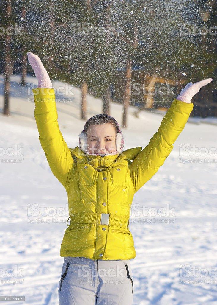 Girl throwing snow stock photo