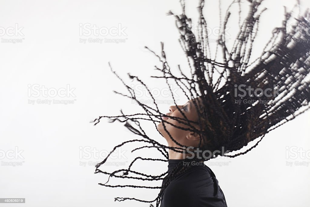 Girl throwing up her braids royalty-free stock photo