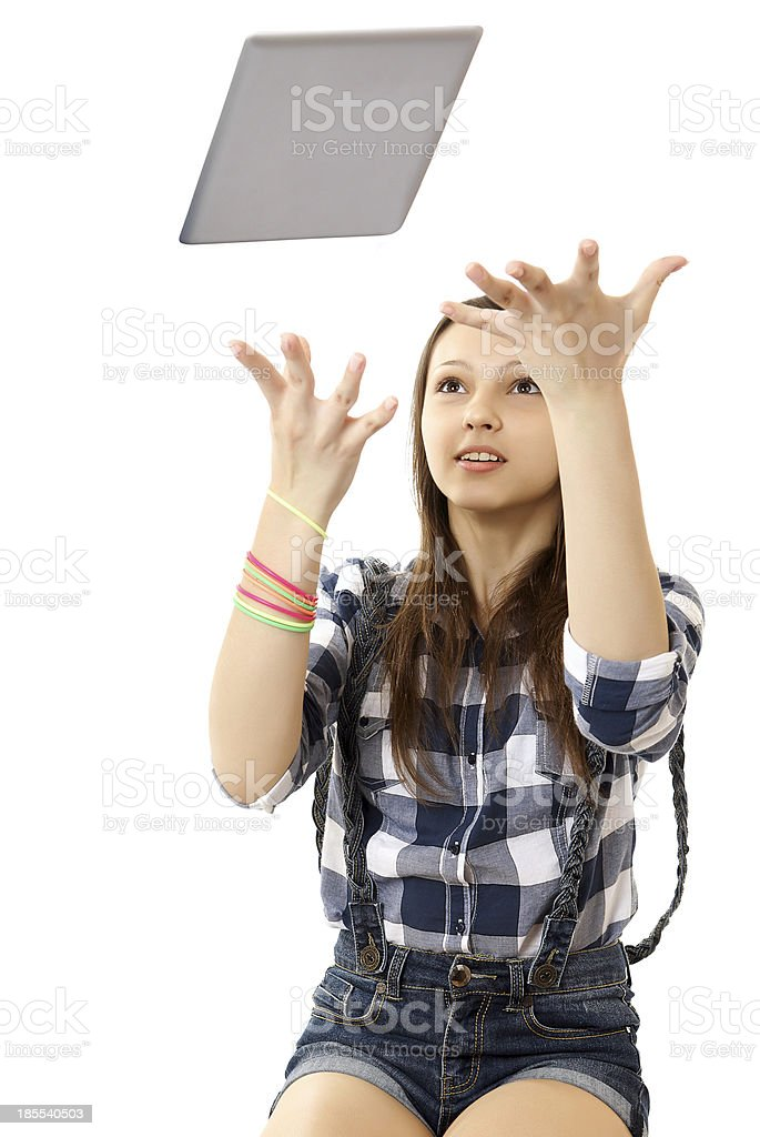Girl throws in the air tablet PC . royalty-free stock photo