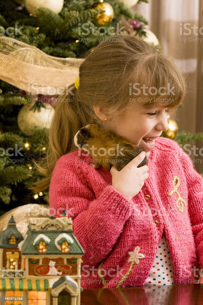 Girl Tickled by her Pet royalty-free stock photo