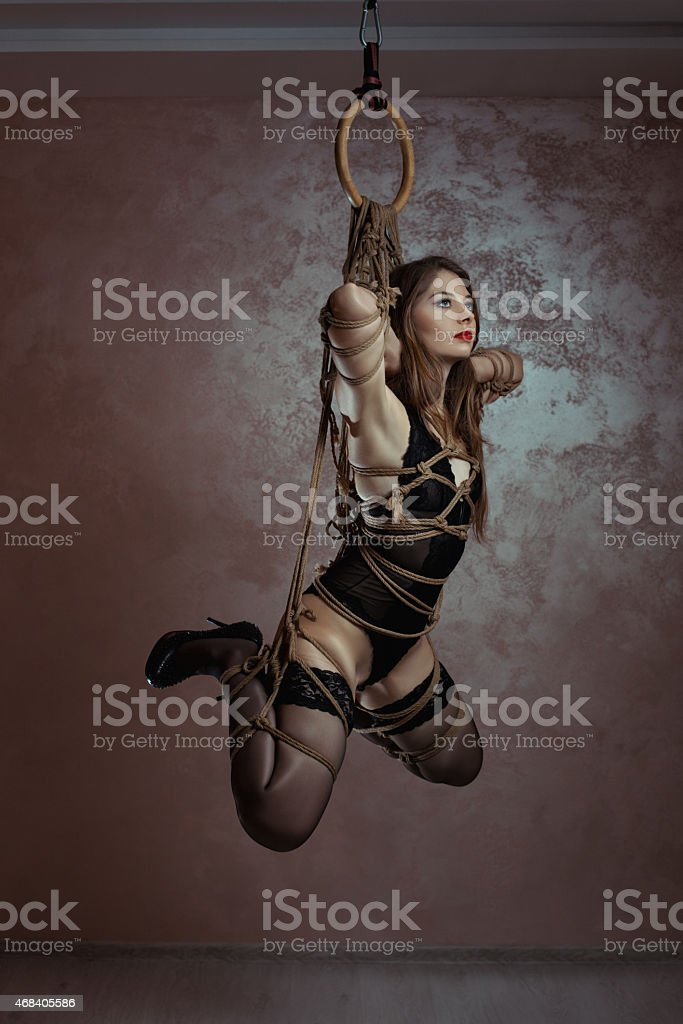 Girl tied hanging. stock photo