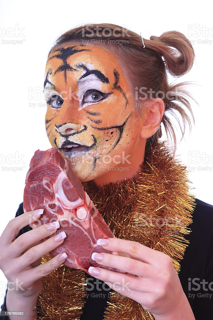 Girl tiger with the piece of raw meat. royalty-free stock photo
