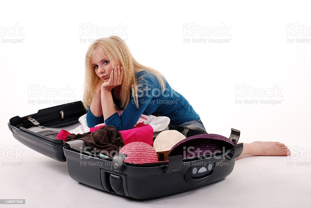 Girl to packing one's things into a suitcase royalty-free stock photo