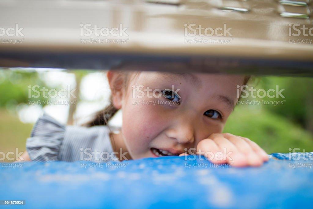 Girl to peep royalty-free stock photo