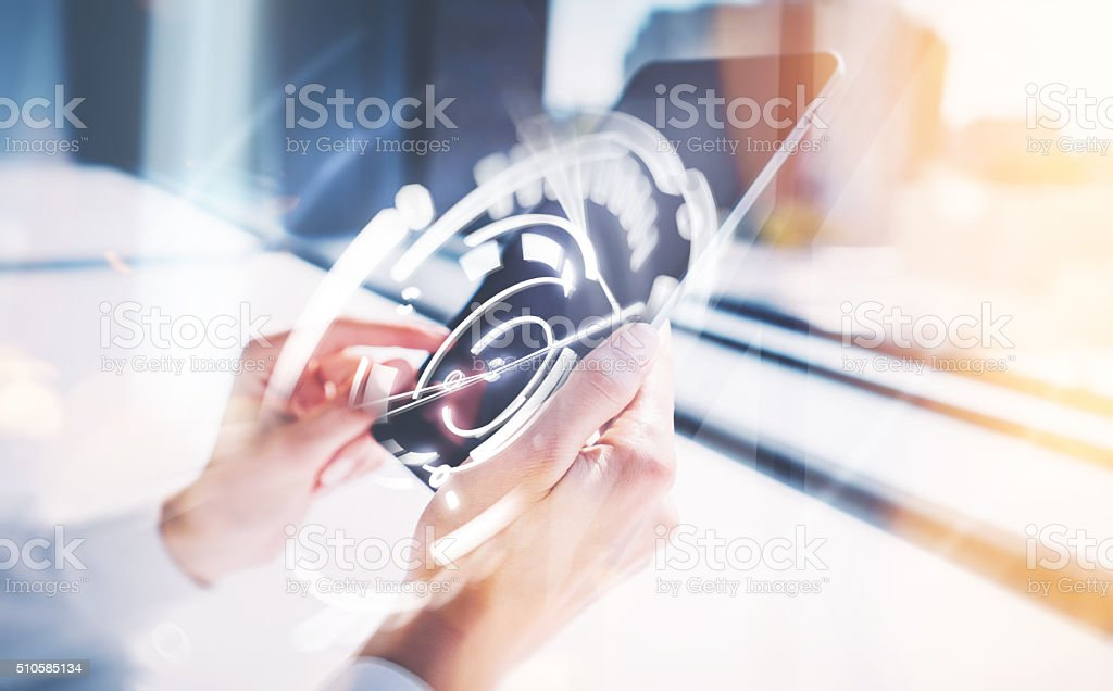 Girl touching screen of tablet, visual interfaces effects. Blurred background stock photo