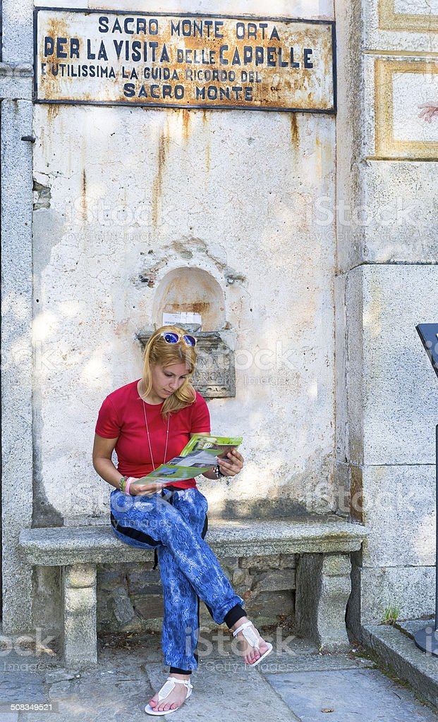 Girl tourist at the Sacro Monte di Orta. Color image stock photo