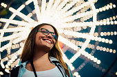 Tourist girl in an amusement park smiling