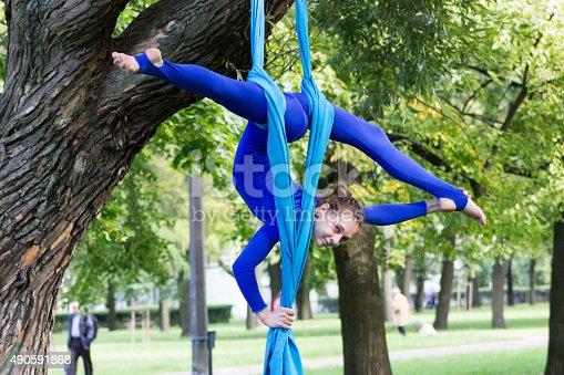 istock Girl training on silks on open air 490591868