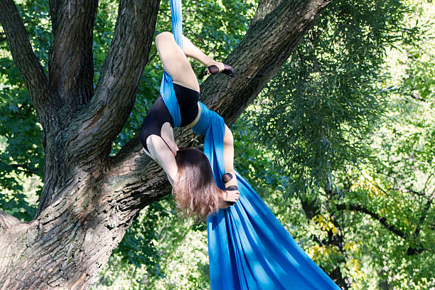 Girl training on silks on open air stock photo