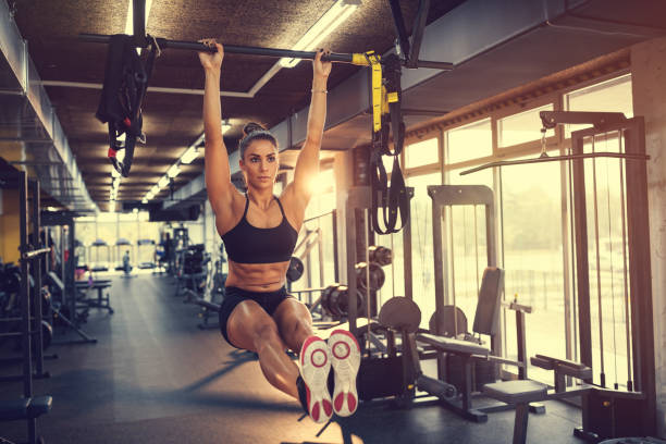 Girl training plank in gym stock photo