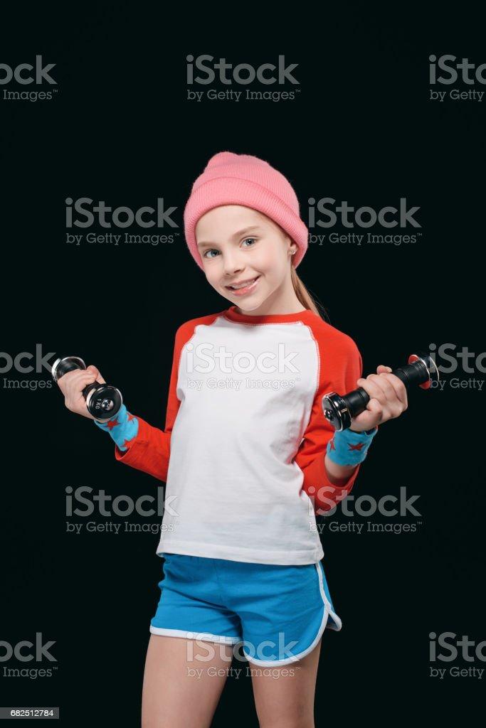 kız siyah izole dumbbells ile eğitim. etkin çocuklar izole kavramı royalty-free stock photo