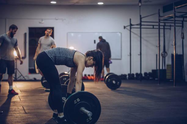 Girl training with men stock photo
