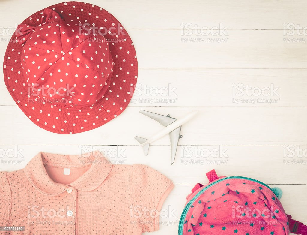 Girl travel accessories summer vacation objects on white wood stock photo
