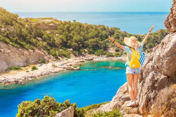 Girl traveler admires the beautiful wild Bay in a tropical Paradise place on Earth stock photo