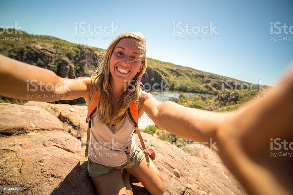 Girl traveling takes a selfie portrait in national park stock photo