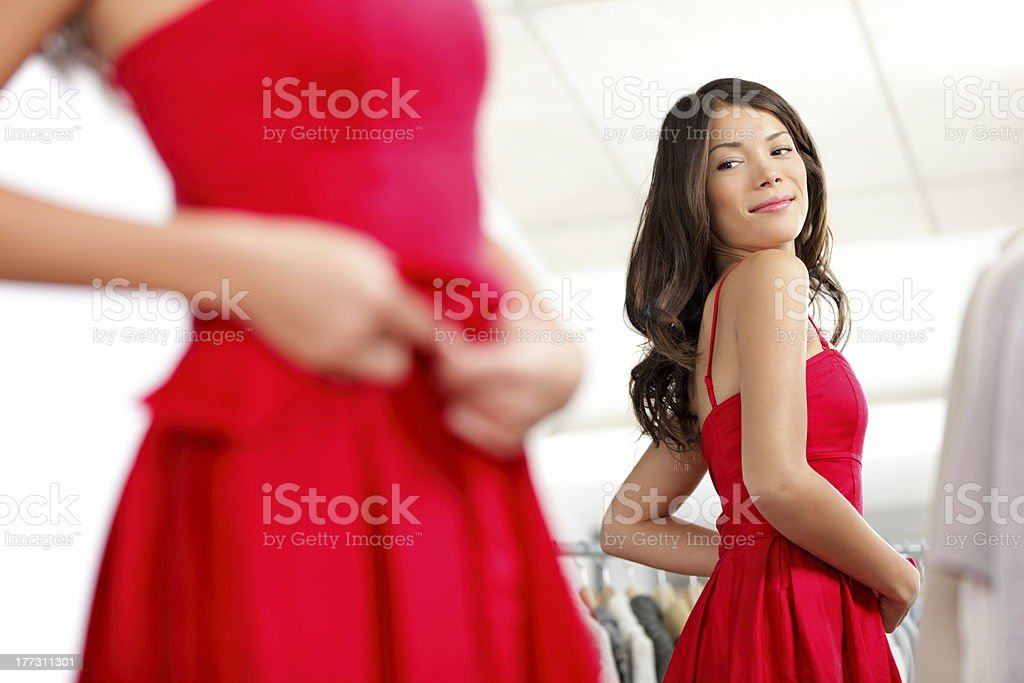 Girl trying dress stock photo