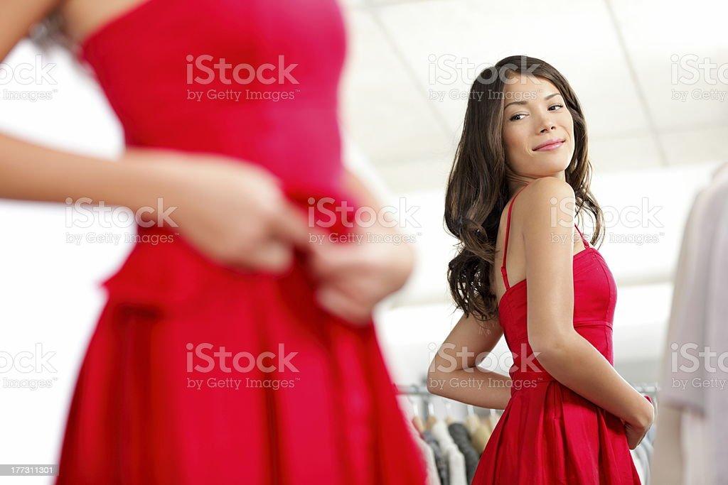 Girl trying dress stock photo