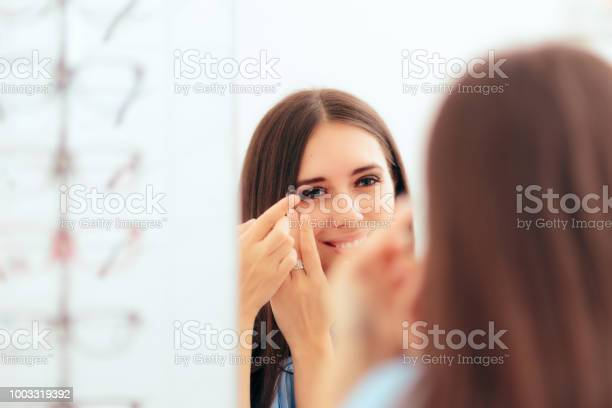 Girl trying on medical contact lenses in the mirror picture id1003319392?b=1&k=6&m=1003319392&s=612x612&h=g dneh0 cwusn4hxx7vtwd3dnuo65aqq0i2xlc4apwc=