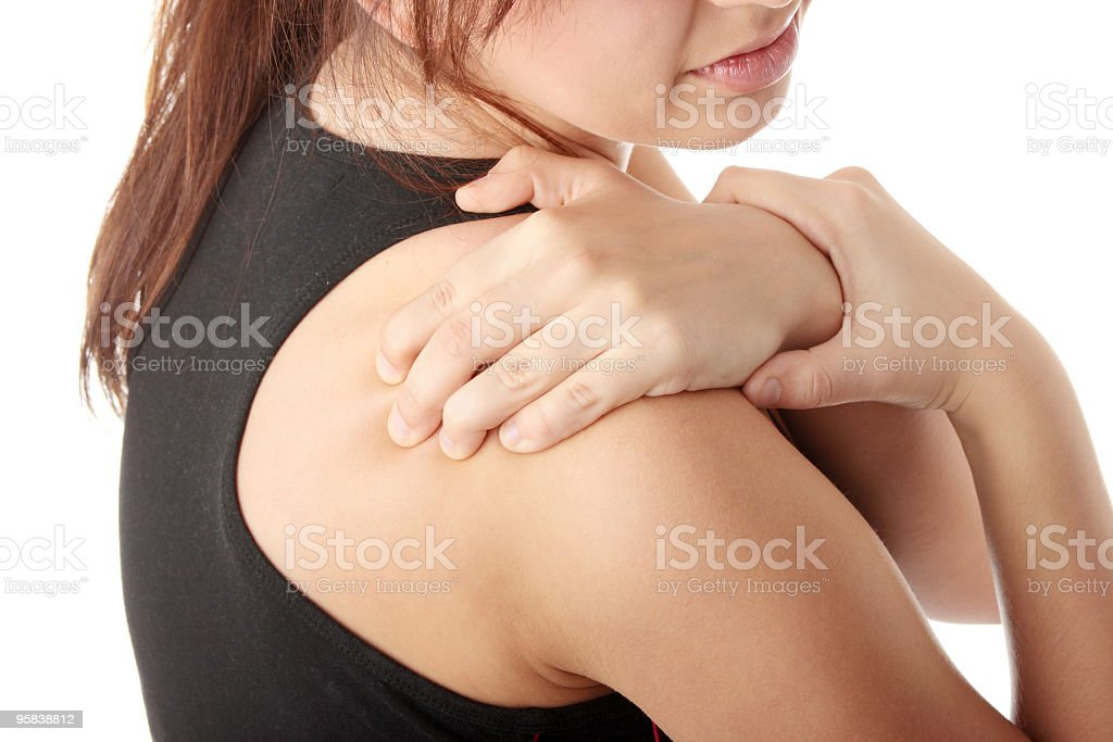 Girl trying to help her shoulder pain stock photo