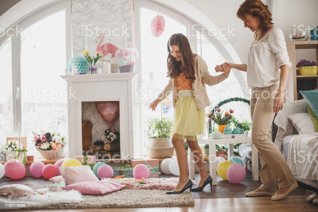 Girl Trying To Walk In Mothers High Heels Stock Photo ...
