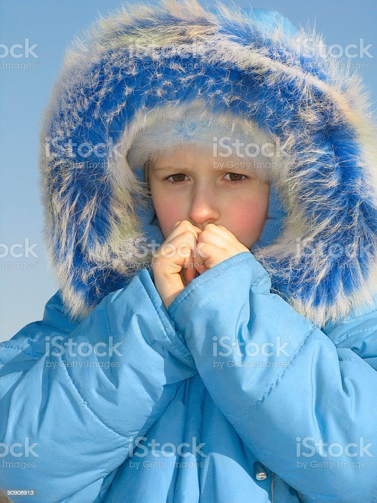 Girl trying to warm fingers royalty-free stock photo
