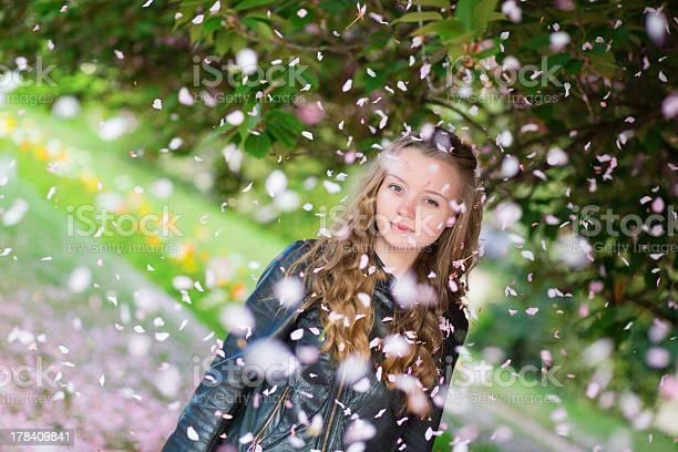 Girl under falling pink petals on a spring day picture id178409841?b=1&k=6&m=178409841&s=612x612&h=xsbtc81h7ooehu8d1nikjunzm4raagtzmw5dsvtht54=
