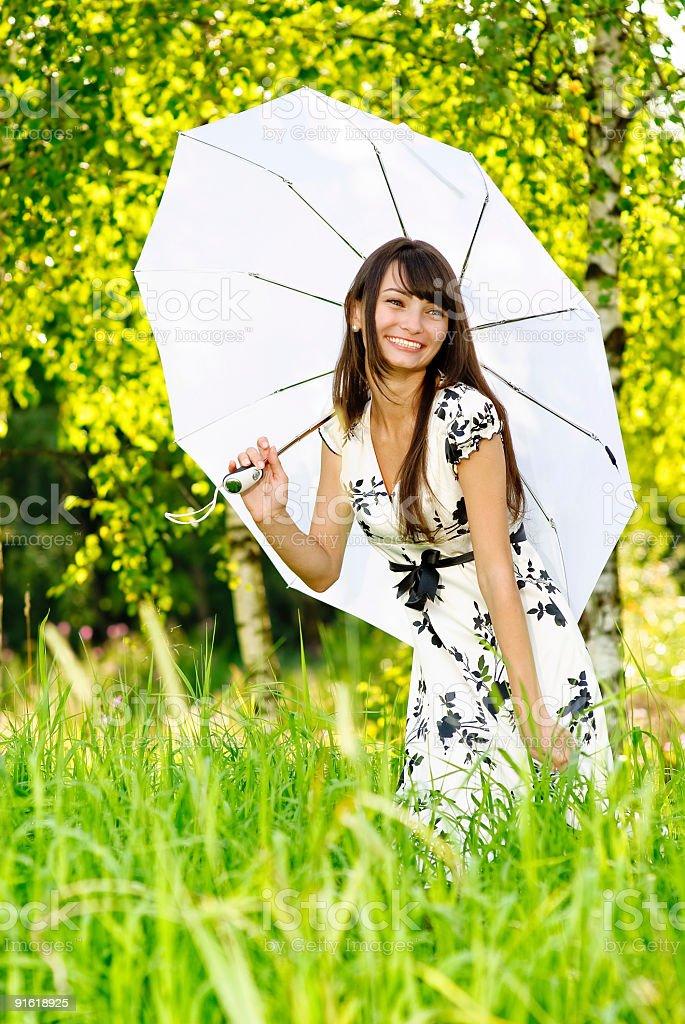 Girl under sun-protection umbrella royalty-free stock photo