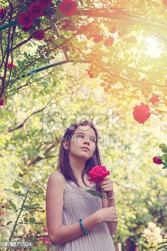 623358818 istock photo Girl under the rose bush 476871504
