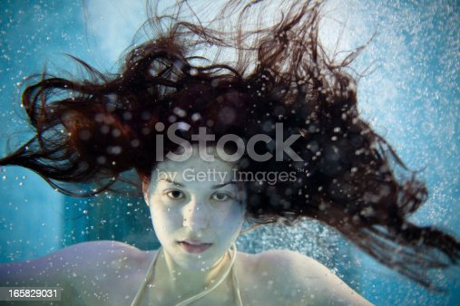 medusa in a swimming pool with wild long hair