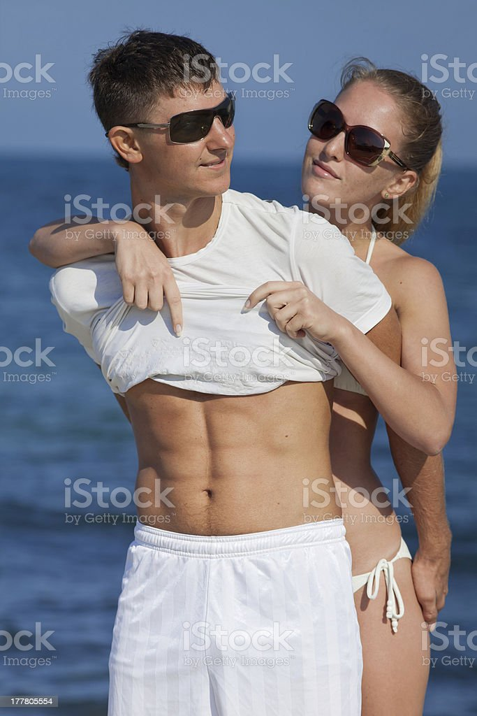 Girl undressing her guy on open air in day time royalty-free stock photo