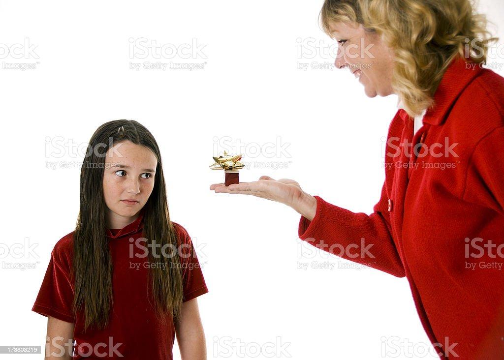 Girl Upset with her tiny Christmas Present stock photo