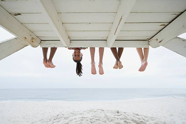 Girl upside down stock photo
