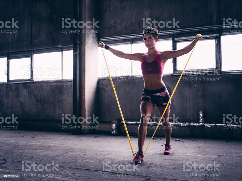Girl using a resistance band in her exercise routine stock photo