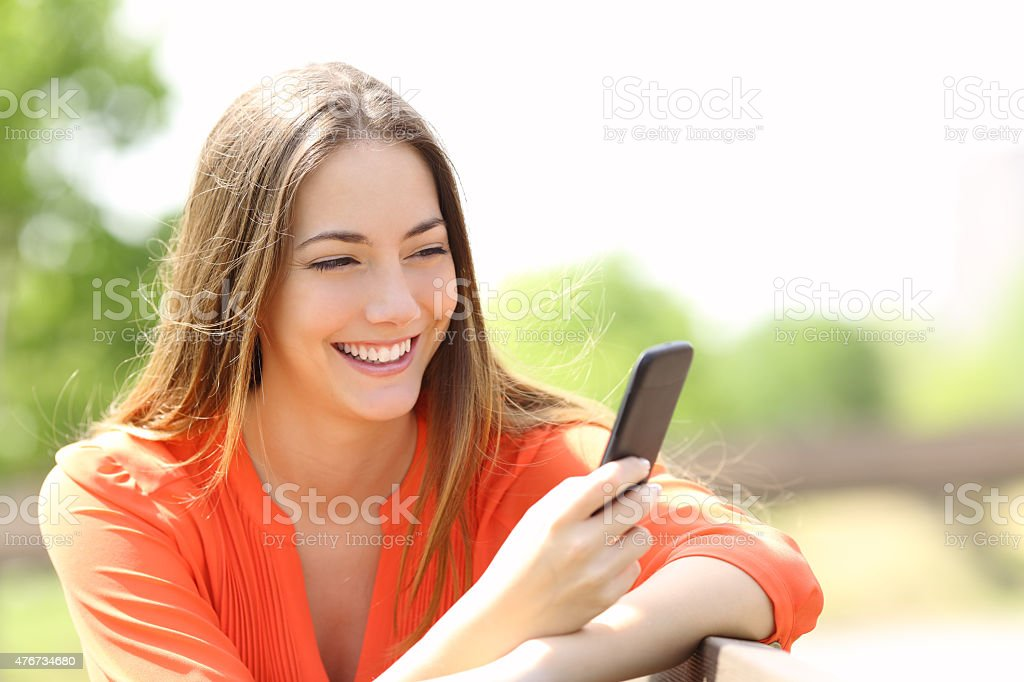 Girl using a smart phone in summer stock photo