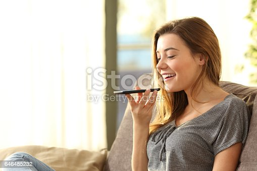 istock Girl using a smart phone voice recognition 646485232