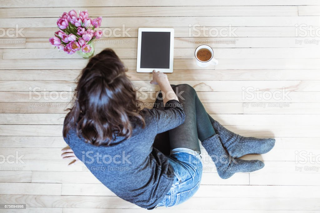 A girl using a tablet royalty-free stock photo