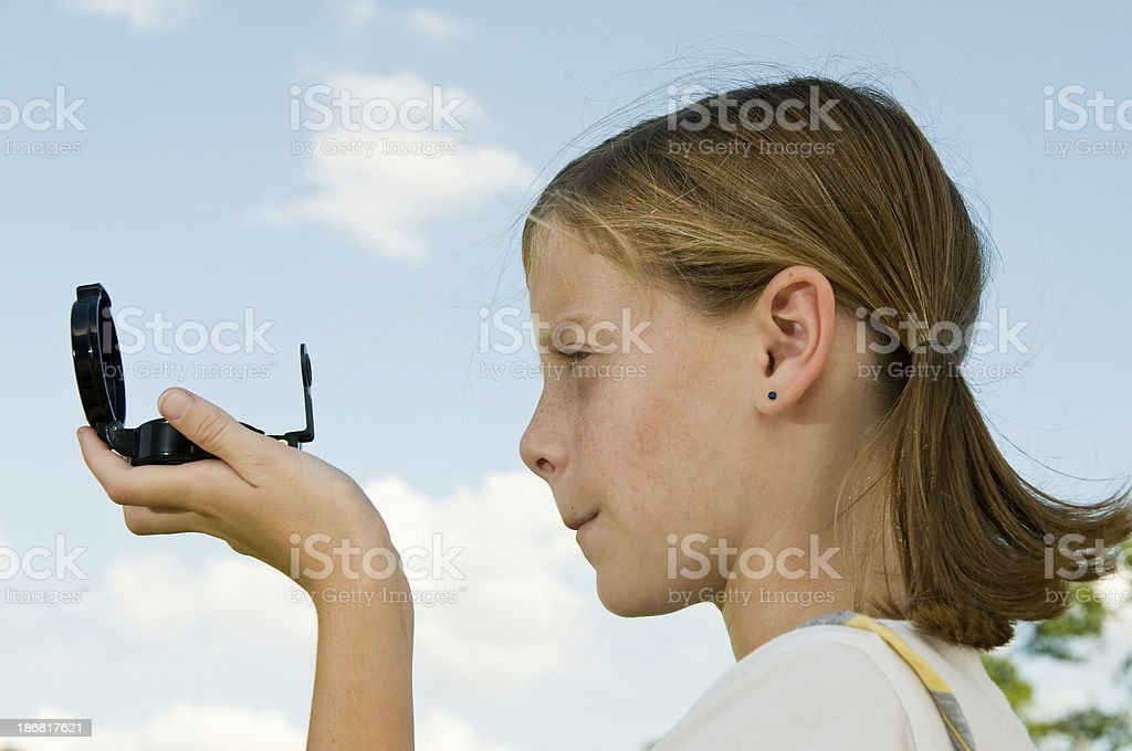 Girl using at compass stock photo
