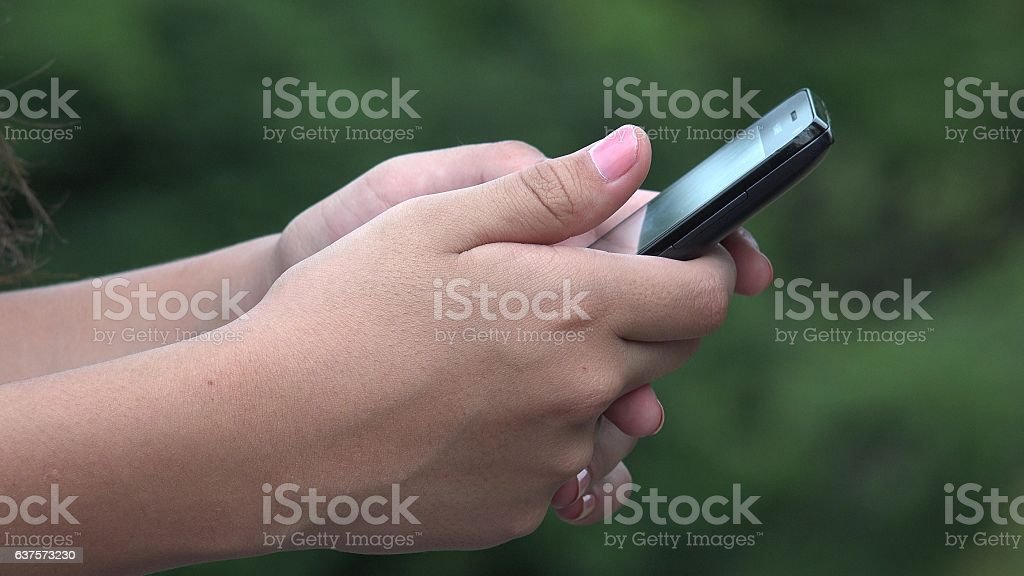 Girl Using Cell Phone stock photo