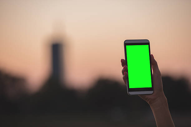 girl using cellphone near the river with chroma key screen. - green screen background stock photos and pictures