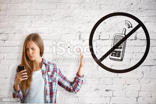 istock Girl using cellphone 690040524