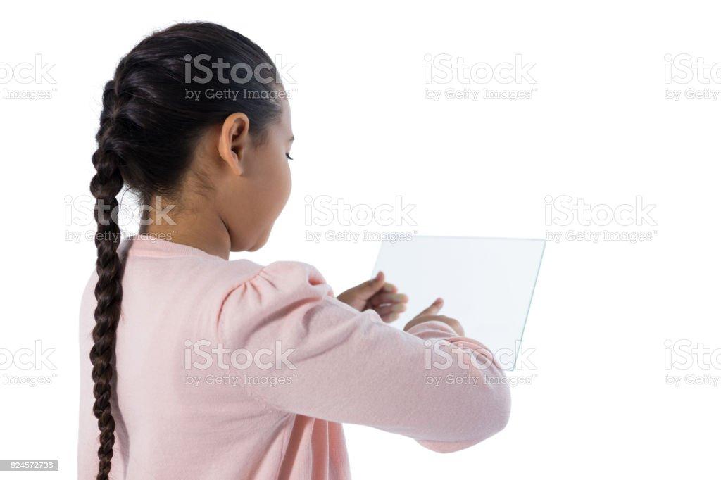 Girl using glass digital tablet stock photo