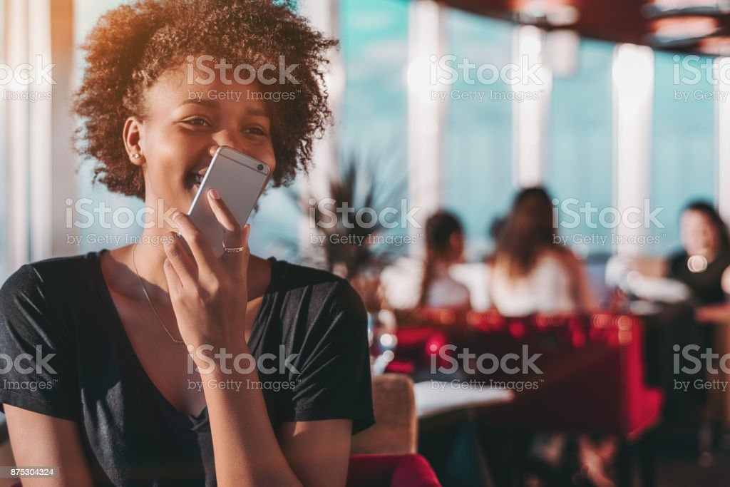 Girl using her smartphone to send audio message stock photo