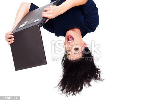 istock girl using laptop computer upside down 178571272