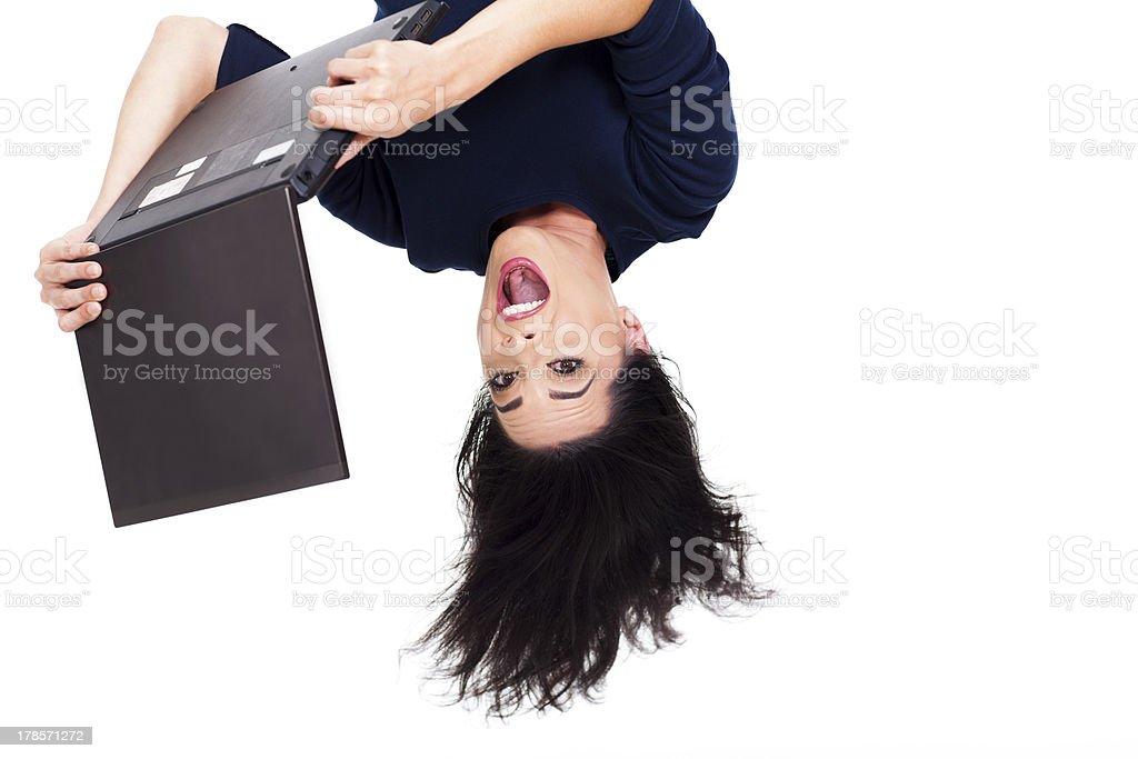 girl using laptop computer upside down stock photo