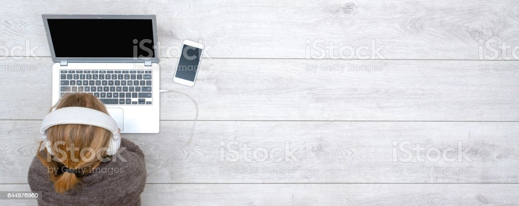 girl using laptop header stock photo